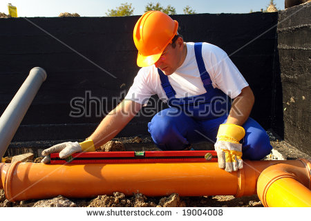stock-photo-plumber-measuring-slope-of-assembled-sewage-pipes-using-spirit-level-19004008